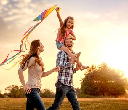 Family flying a kite