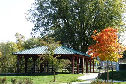 The shelter at Memorial Park with a small tree boasting gold foliage