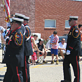 Members of the Honor Guard carrying flags - side view