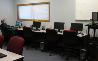 Man works at one of eight stations in the Computer Lab at the Activity Center.