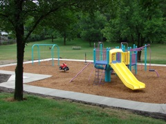 Easton playground with a wooded area in the background
